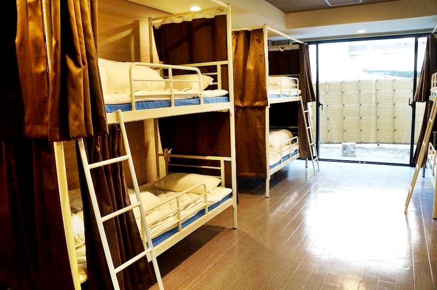 bunks with curtains in a Hostel Dorm Room